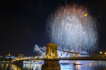 Fireworks over the Danube in Budapest. View of the illuminated Chain Bridge. Hungary Banco de Imagens