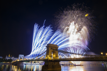 Fireworks in the night sky of Budapest. View of the illuminated Chain Bridge. Hungary Stock Photo