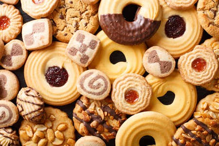 Background of cookies assorted close-up. Horizontal view from above