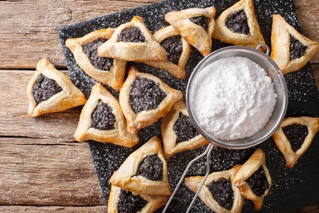 hamantaschen: Traditional Jewish holiday food - Purim Hamantaschen close-up on the table. horizontal view from above