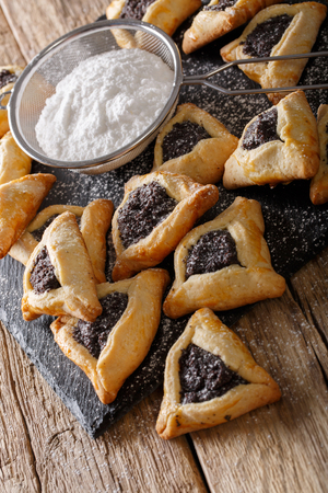 Hamantaschen cookies or hamans ears traditional Jewish sweet closeup on the table. vertical Stock Photo