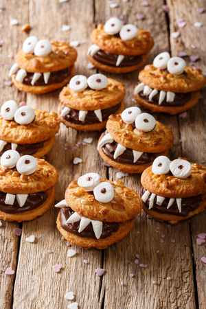 Peanuts chocolate cookies monsters close-up on a table for Halloween. Stock Photo