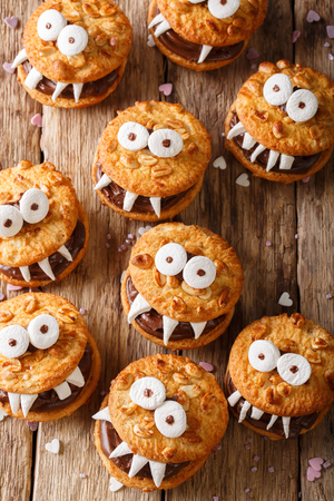 Peanut cookie monsters for halloween close-up on the table. top view from above