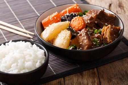 Galbi jjim or Kalbi Jim - Korean Braised Beef Short Ribs with rice closeup. horizontal Stock Photo
