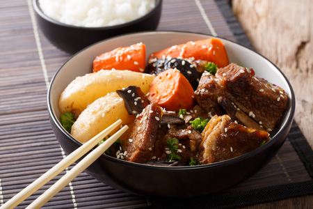 Galbi jjim Korean Braised Beef Short Ribs with rice close-up on the table. Horizontal