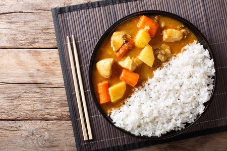 Japanese curry rice with meat, carrot and potato close-up on a plate on a table. horizontal top view from above Stock Photo - 89371694