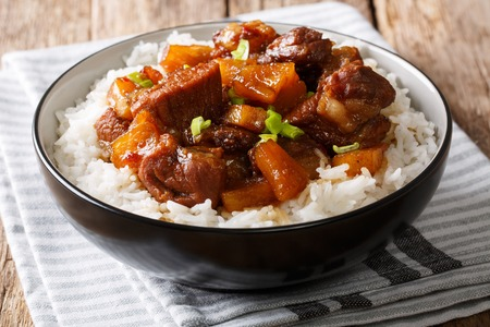 Filipino food: belly pork hamonado with pineapple and rice close-up in a bowl on the table. horizontal  Stock Photo