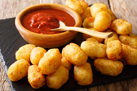 Deep fried Potato Tater Tots and ketchup close-up on the table. horizontal  Stock Photo
