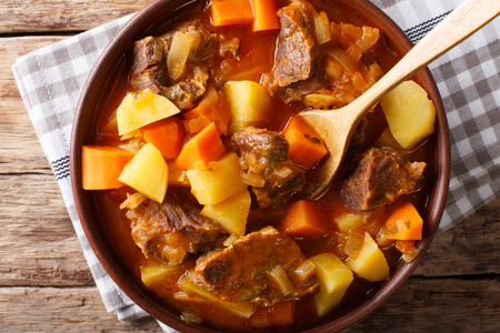 Mexican thick estofado soup with beef close-up in a bowl. horizontal top view from above Stok Fotoğraf