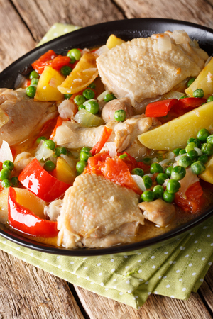 Popular Filipino meal stew of chicken with vegetables - afritada closeup in a bowl on the table. vertical Stock Photo
