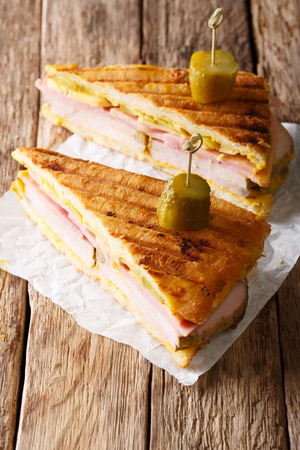 Delicious hot Cuban sandwich close-up on paper on the table. vertical Stock Photo - 91711660