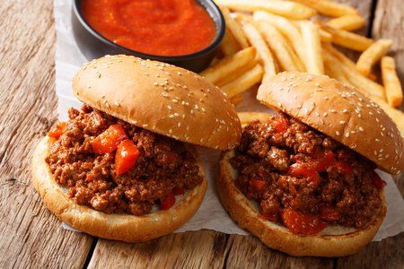 American nourishing sandwiches Sloppy Joe and french fries, ketchup closeup on the table. horizontal