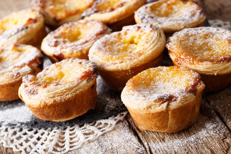 Delicious cakes Pastel de nata with custard cream close-up on the table. horizontal