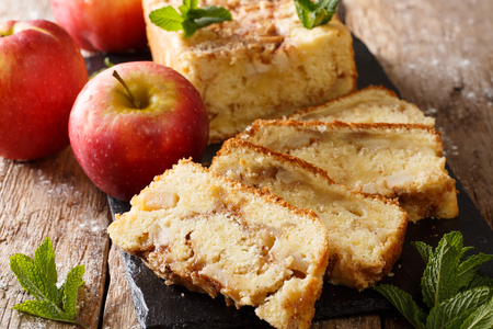 Delicious homemade apple bread with cinnamon and mint close-up on the table. horizontal