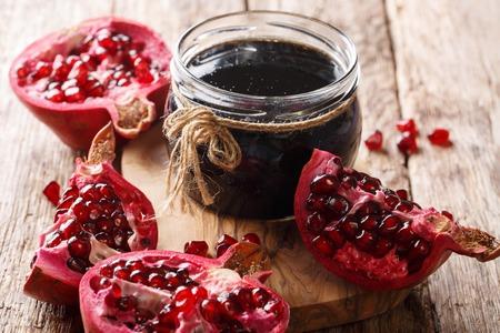 Azerbaijani narsharab seasoning obtained by thickening pomegranate juice close-up on the table. horizontal Imagens