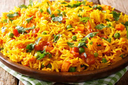 Spicy rice Mumbai Tawa Pulao with vegetables close-up on a plate. horizontal