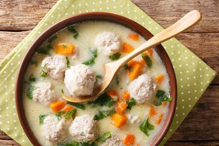 Tasty Bulgarian soup topcheta with meatballs close-up in a bowl on the table. horizontal top view from above Stock Photo