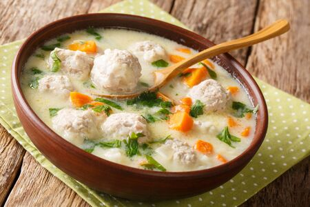 Traditional soup with meatballs, yogurt and vegetables close-up in a bowl on the table. Stock Photo