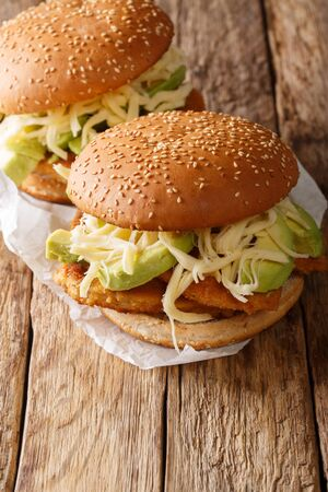Spicy Chipotle Chicken Cemita Sandwich  close-up on the table. vertical Stock Photo