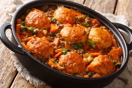 Tasty meatballs served with lentils and vegetables close-up in a pan on the table. horizontal