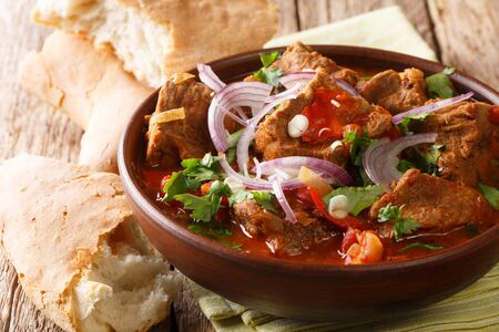 Similar to a goulash, chashushuli is a hearty beef and tomato stew hailing from Georgia close-up in a bowl on the table. horizontal Reklamní fotografie