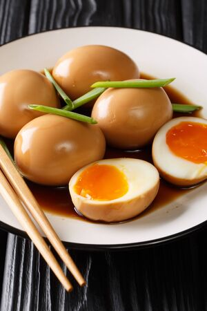 Japanese nitamago eggs close-up in a plate on the table. vertical