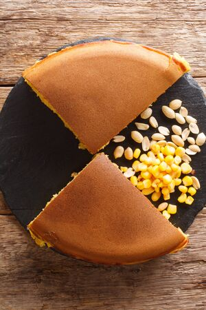 Apam Balik stuffed with sweet corn, peanuts, butter and sugar close-up on the table. vertical top view from above