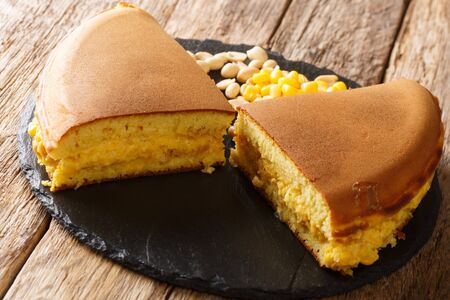Apam balik is a Southeast Asian fluffy pancake with cream corn and peanuts close-up on the table. Horizontal