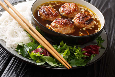 Bun cha Hanoi is a delicious Vietnamese street food combining flavorful meatballs, rice noodles and a tangy dipping sauce. Horizontal