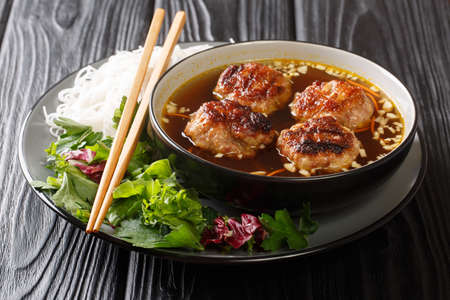 Vietnamese Grilled Pork Meatballs with Vermicelli Noodles Bun Cha is a classic Northern Vietnamese dish closeup in the plate on the table. Horizontal