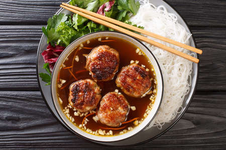 Bun cha Hanoi is a delicious Vietnamese street food combining flavorful meatballs, rice noodles and a tangy dipping sauce. Horizontal top view from above Stock fotó - 155447037