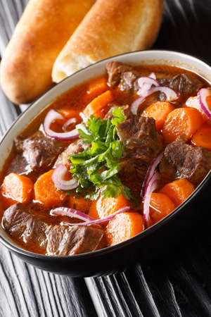 Vietnamese bo kho beef stew is packed with tender, fall-apart braised chunks of beef loaded with herbs, aromatics and a delicious broth closeup in bowl. Vertical 免版税图像