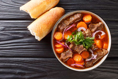 Authentic Vietnamese Beef Stew Bo Kho closeup in bowl on the table. Horizontal top view from above 免版税图像