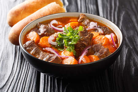 Bo kho is a delicious spicy beef stew dish, that is popular in Vietnam close-up in a bowl on the table. Horizontal Banco de Imagens
