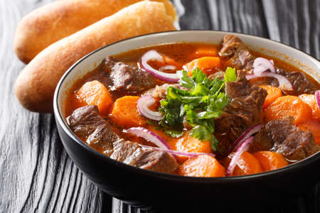 Authentic Vietnamese Beef Stew Bo Kho closeup in bowl on the table. Horizontal Banco de Imagens