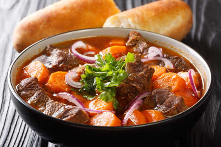 Bo Kho recipe this Vietnamese beef stew has all the flavors of a traditional beef stew with additional aromatics from lemongrass and star anise closeup in bowl on the table. Horizontal