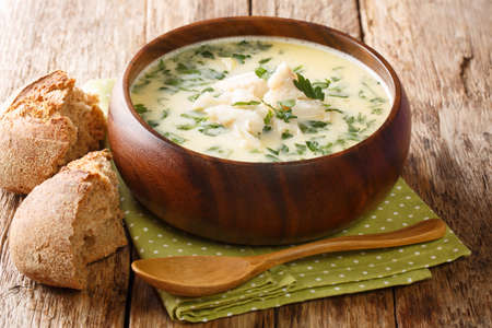 Delicious cream soup cullen skink cooked with smoked haddock and potatoes close-up in a bowl on the table. horizontal