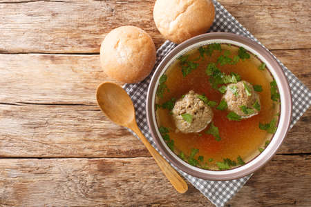 Tasty Liver dumplings added to broth make a wonderful authentic German soup close-up in a plate on the table. horizontal top view from above