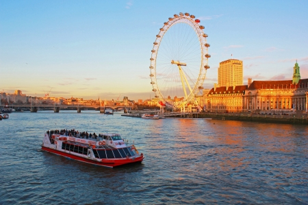 London, boat on the Thames and London Eye