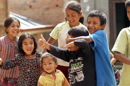 Nepal, Kathmandu Valley, october 10, 2010. Young boys trying to tease on the street of Kathmandu