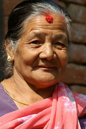 Nepal, Kathmandu Valley, october 10, 2010. Old woman protrait in national clothes on the street of old town