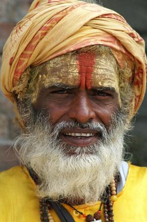 Nepal, Kathmandu Valley, october 11, 2010. Shaiva sadhu (holy man) seeking alms in front of a temple in Pashupatinath (Nepal, Kathmandu)