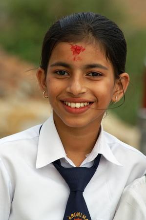 Nepal, Kathmandu Valley, october 11, 2010. School teenager smile on the protrait