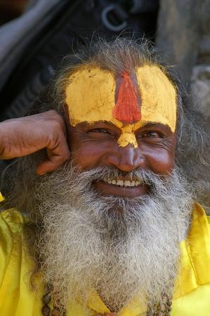 guru: Nepal, Kathmandu Valley, octiber 11, 2010. Shaiva sadhu (holy man) protrait seeking alms in front of a temple in Pashupatinath (Nepal, Kathmandu Editorial