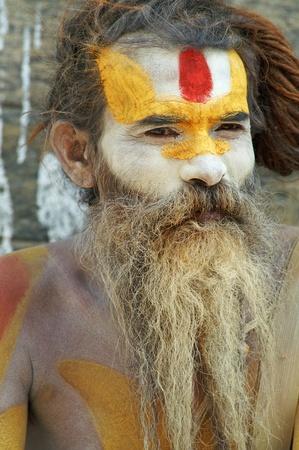 Nepal, Kathmandu Valley, octiber 110, 2010. Shaiva sadhu (holy man) seeking alms in front of a temple (Nepal, Kathmandu)