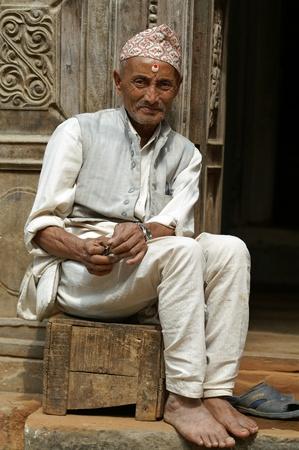 Kathmandu, Nepal, october 11, 2010: old nepalese man sitting on the street