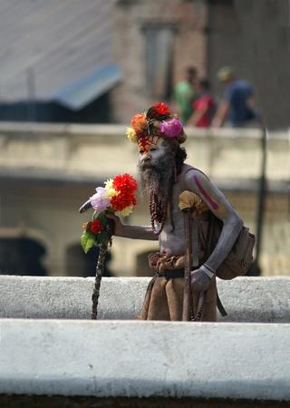 Kathmandu, Nepal, october 11, 2010: sadhu (holy man) walking on the bridge