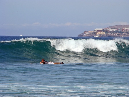 boarders: Tenerife, Canarian Island - October 1, 2011: surfer go back to point breack of the waves