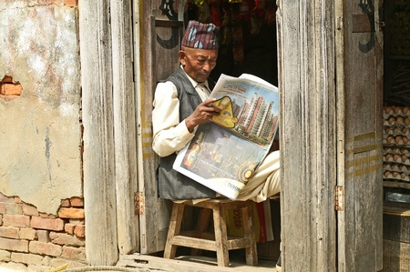 Kathmandu, Nepal - October 10, 2010: nepalese man who read the newspaper