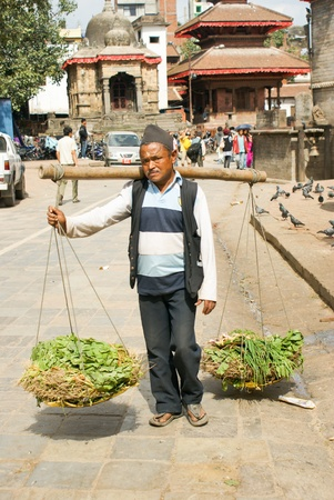 Kathmandu, Nepal - October 10, 2010: porterman walking on the street